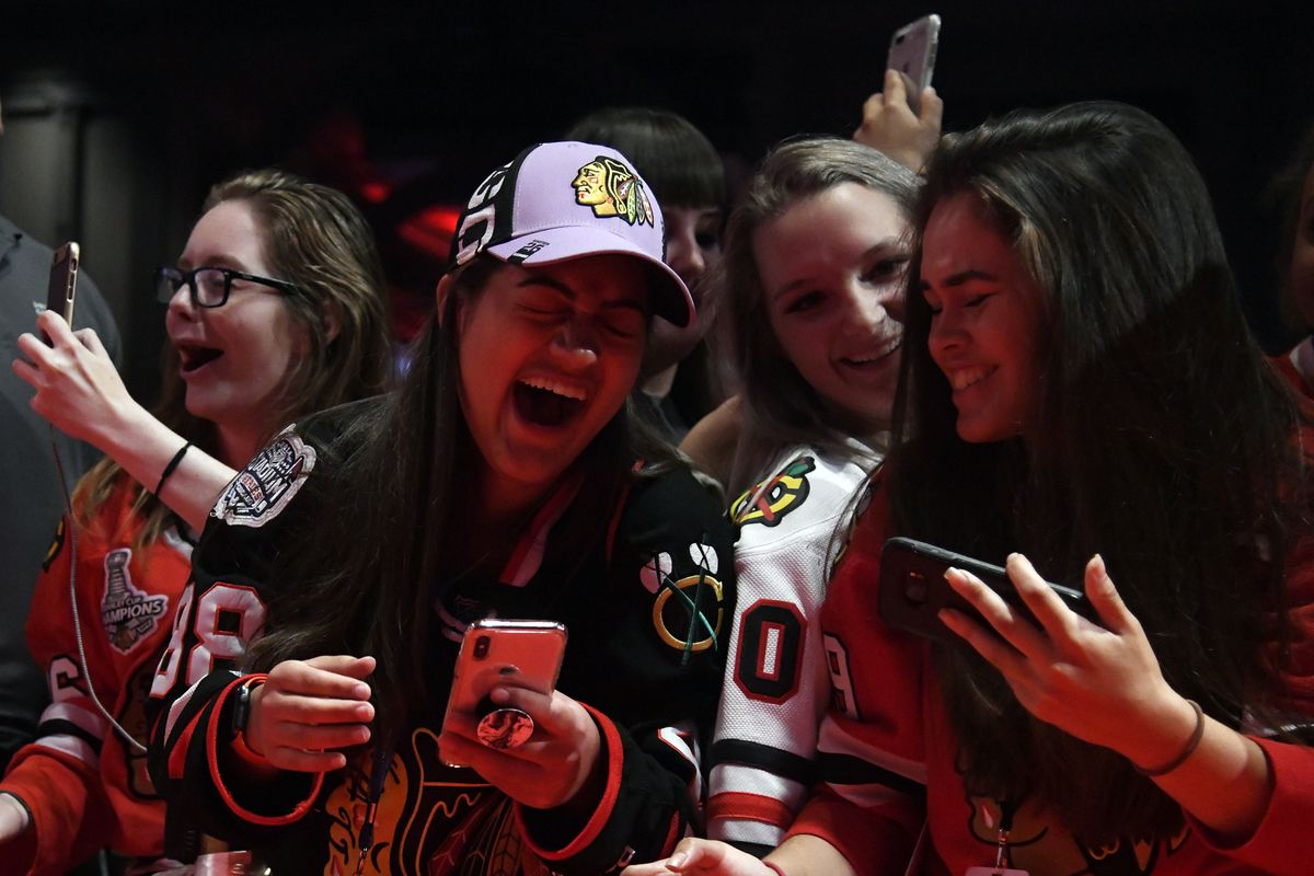 Fans react to Chicago Blackhawks' Patrick Kane giving them a high-five during the NHL hockey team's convention Friday, July 27, 2018, in Chicago. (AP Photo/Annie Rice)