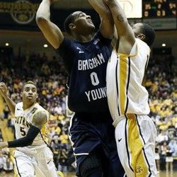BYU forward Brandon Davies (0) tries to shoot over the defense of Southern Mississippi forward Daveon Boardingham in the first half of their NIT college basketball game in Hattiesburg, Miss., Wednesday, March 27, 2013.