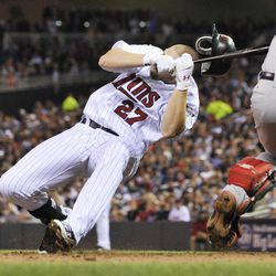 Minnesota Twins' Chris Parmelee goes down after he was hit in the helmet by a pitch from Boston Red Sox pitcher Justin Thomas in the sixth inning of a baseball game Wednesday, April 25, 2012, in Minneapolis. Parmelee left the game.