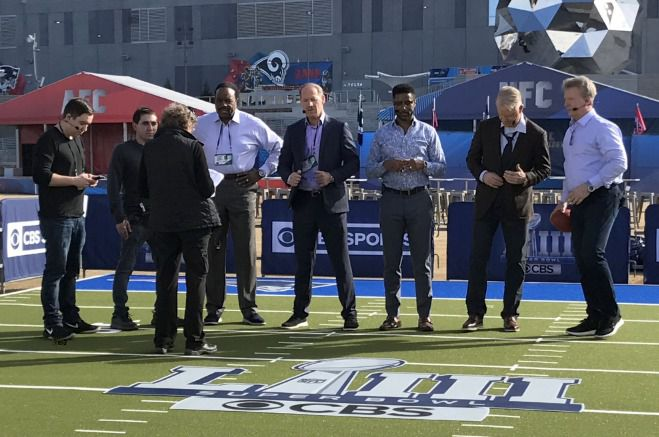 Theo Rabinowitz, second from left, on set during rehearsal for the 2019 Super Bowl pregame show in Atlanta.