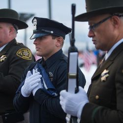 The U.S. Honor Flag is carried into the Maverik Center in West Valley City on Monday, Jan. 25, 2016, prior to funeral services for Unified police officer Doug Barney.