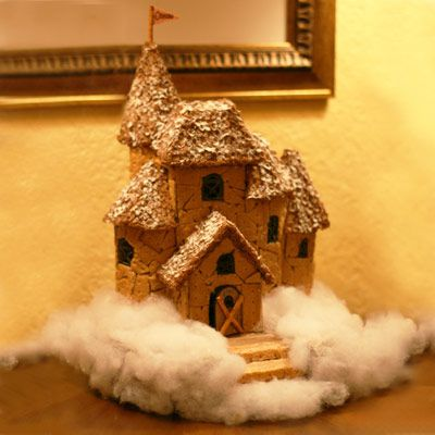 A gingerbread home with cotton candy clouds around it.