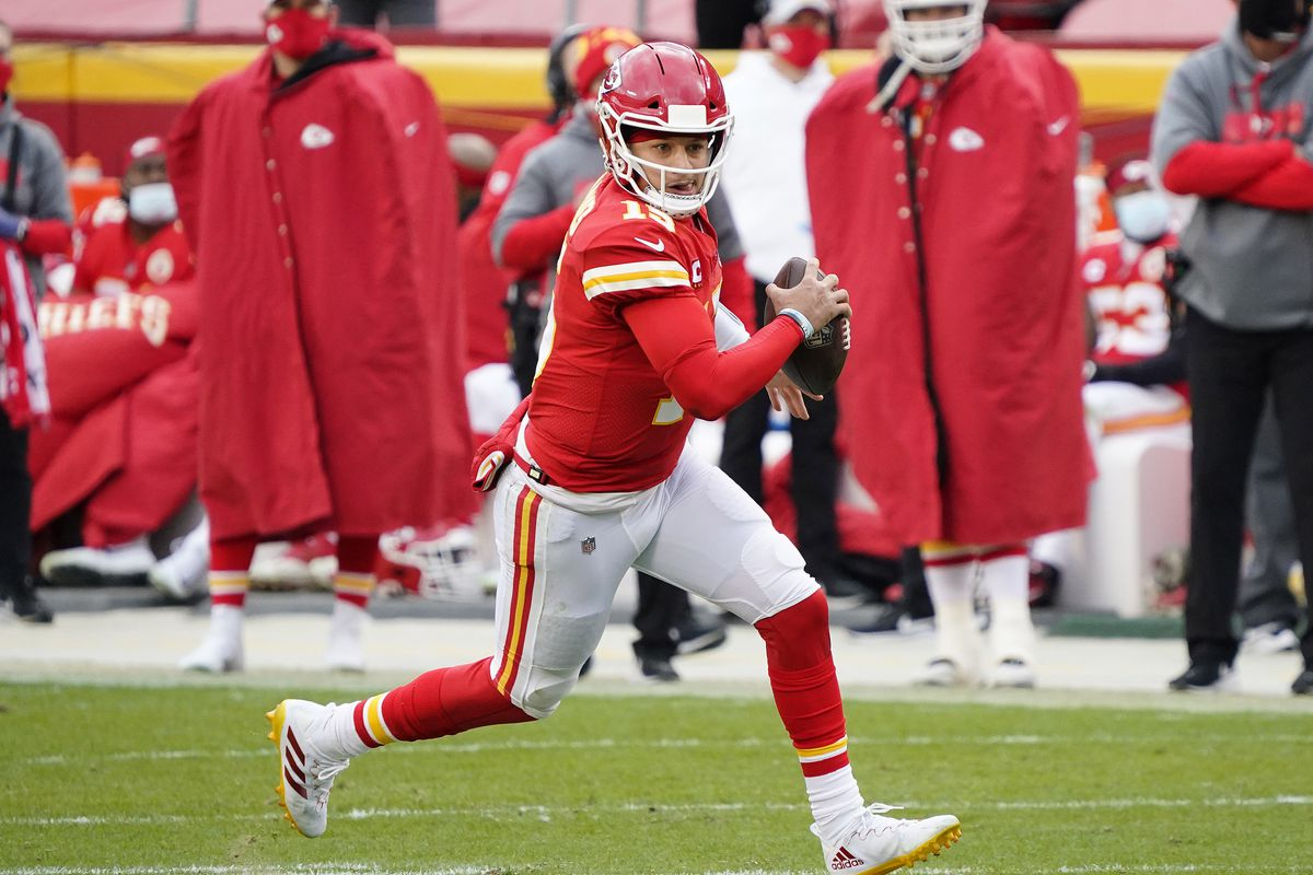 Kansas City Chiefs quarterback Patrick Mahomes (15) runs the ball against the Cleveland Browns during the first half in the AFC Divisional Round playoff game at Arrowhead Stadium.