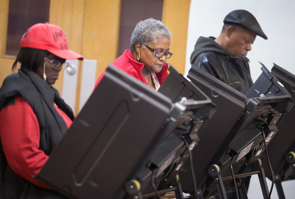 Residents cast their votes at a polling place on November 4, 2014 in Ferguson, Missouri.