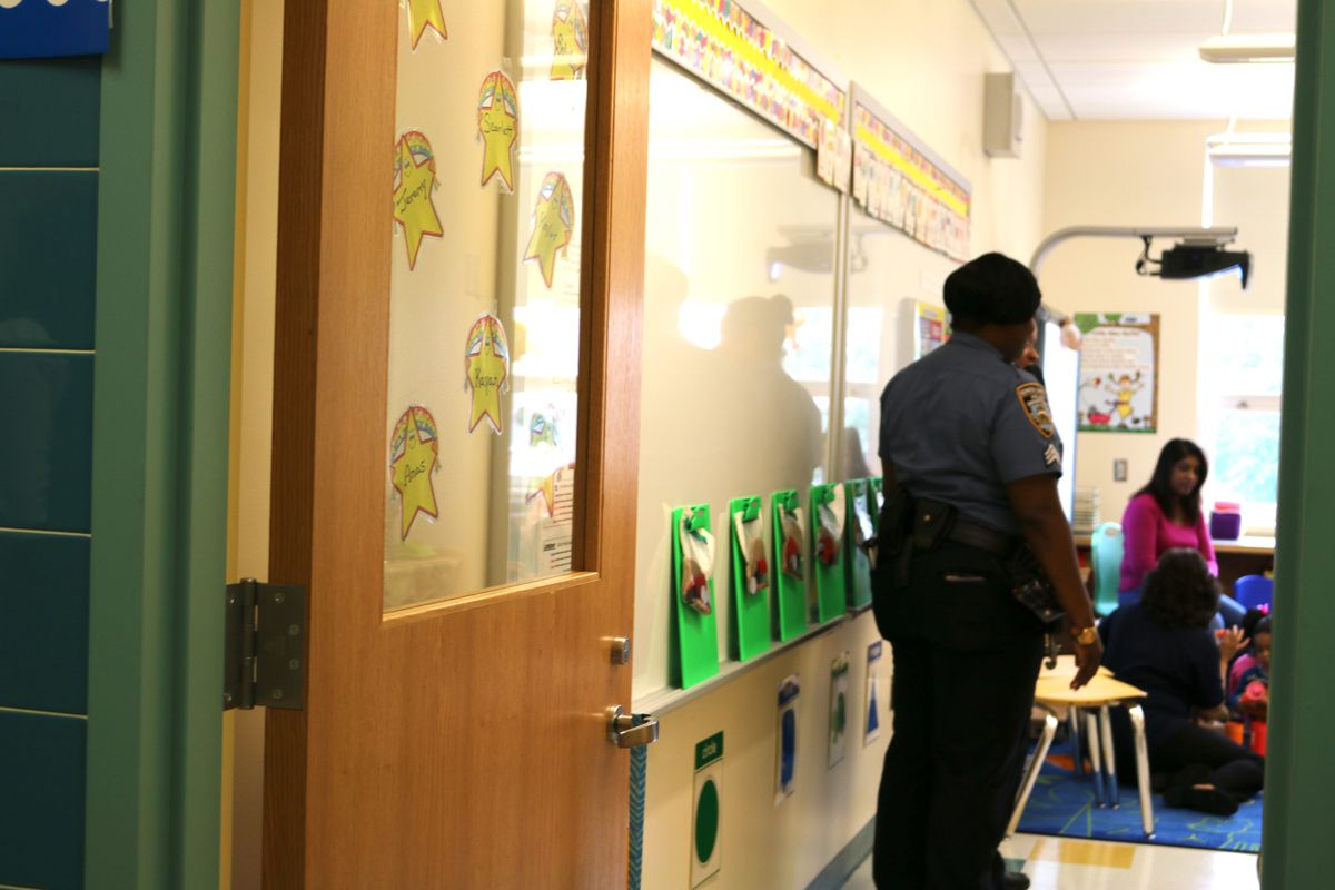 A member of the New York Police Department visits a classroom at Queens Explorers Elementary School.