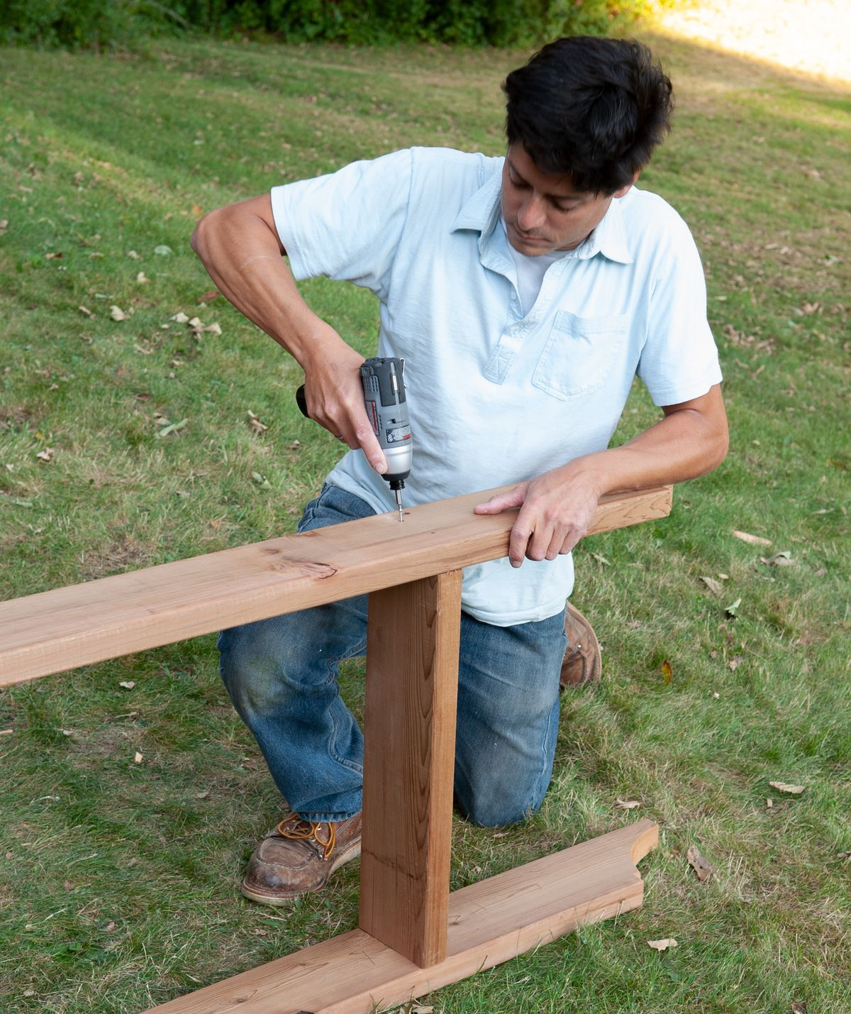 Man Installs Rafters With Screws Of Arbor Bench