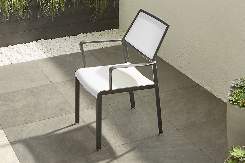 Brown chair with white seat and back.