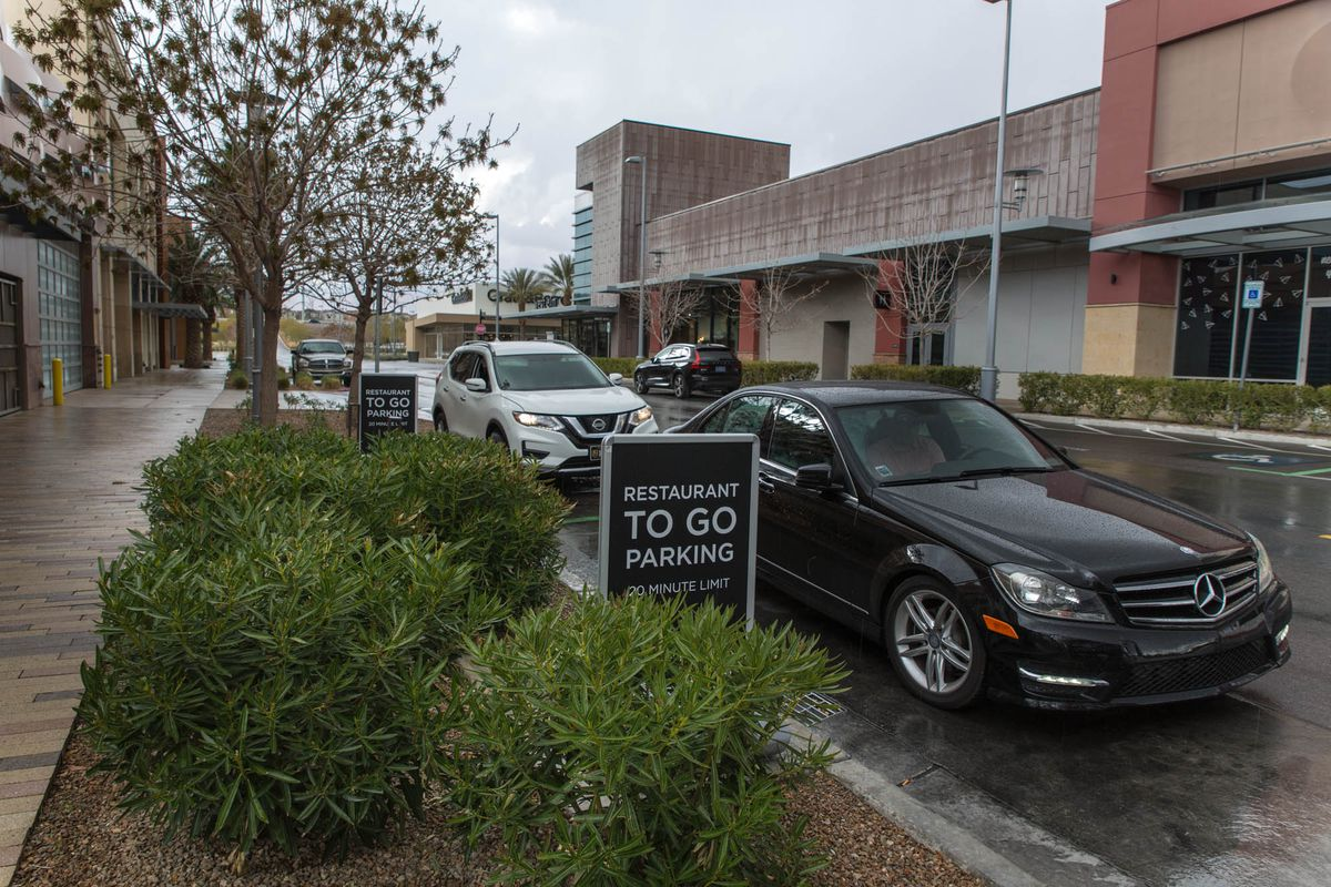 Cars line up to pick up orders from Shake Shack in Downtown Summerlin.