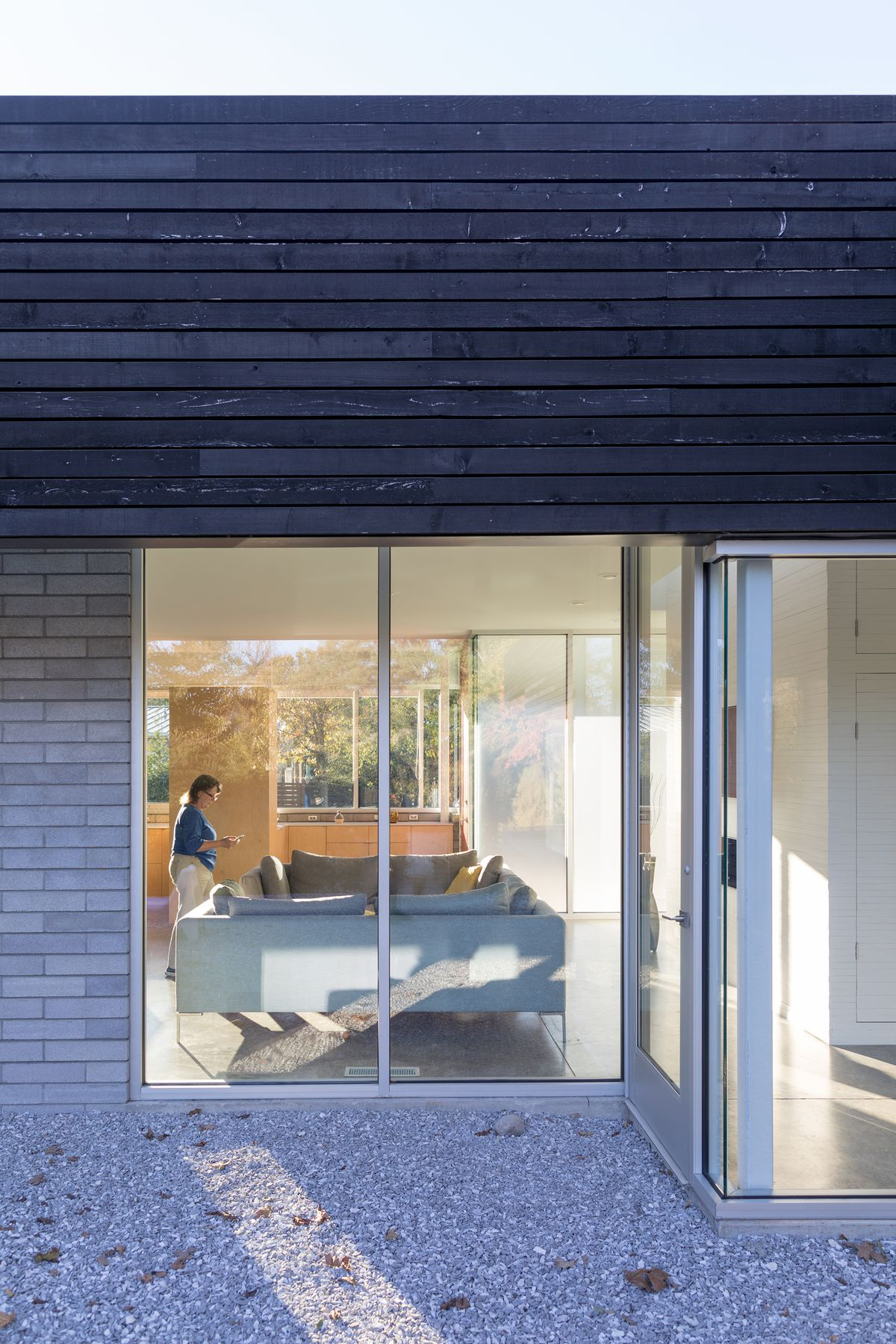 From the outside, you can look through the house thanks to large, glass windows and doors.