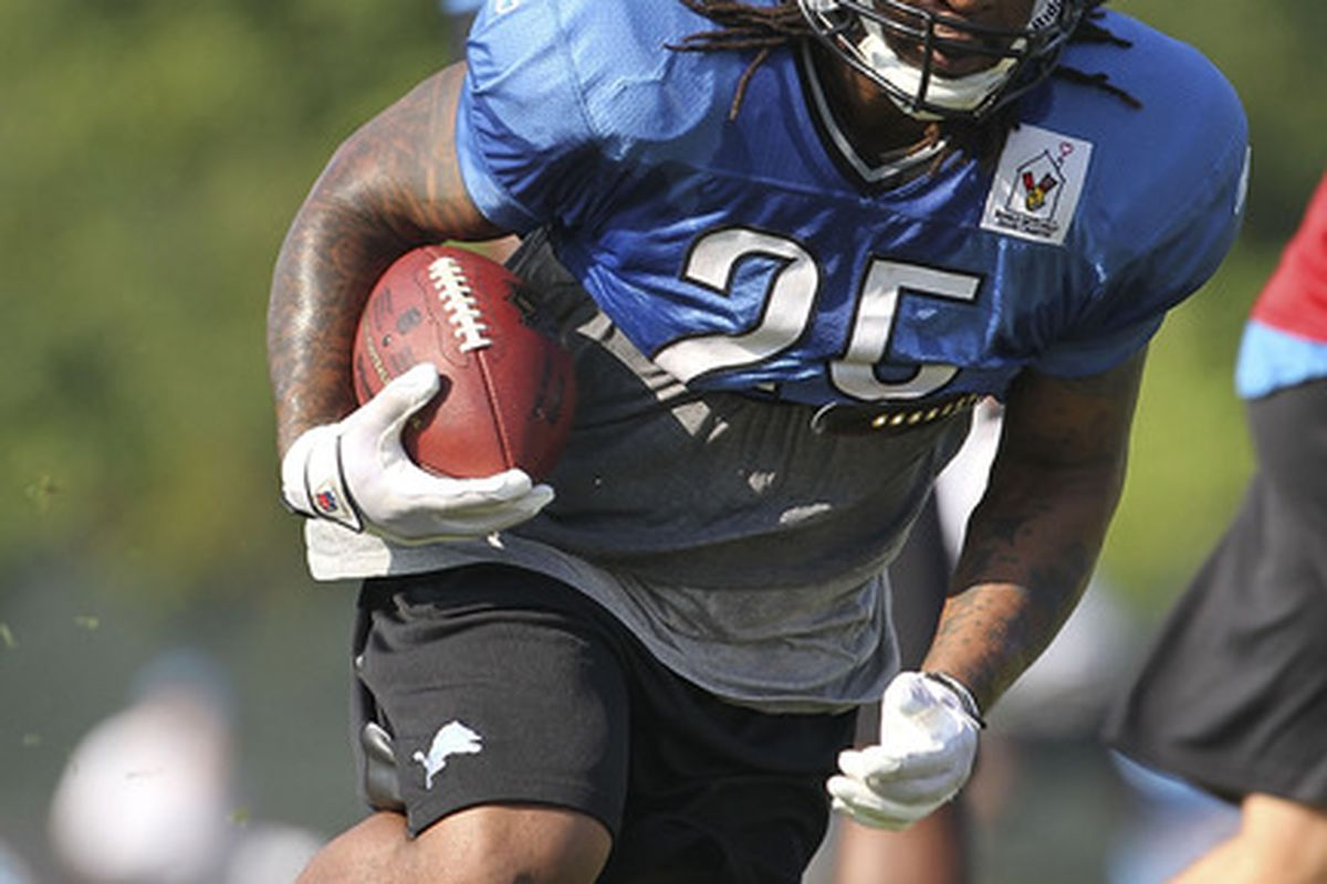 ALLEN PARK, MI - AUGUST 01: Mikel Leshoure #25 of the Detroit Lions runs with the ball during the days drills at the Lions training facility on August 1, 2011 in Allen Park, Michigan.  (Photo by Leon Halip/Getty Images)