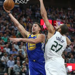 Golden State Warriors guard Klay Thompson (11) goes to the hoop against Utah Jazz center Rudy Gobert (27) during the game at Vivint Arena in Salt Lake City on Tuesday, April 10, 2018.