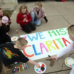Neighbors and family paint signs prior to Clara Lewis' return home from the hospital in Centerville  Thursday, Dec. 29, 2011. Clara Lewis was severely injured in mid-November when her vehicle was struck by a FrontRunner train in Kaysville at a crossing.