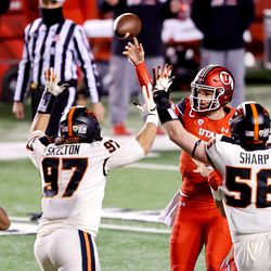 Utah Utes quarterback Jake Bentley (8) passes the ball over Oregon State Beavers defensive lineman Alexander Skelton (97) as Utah and Oregon State play a college football game at Rice-Eccles Stadium in Salt Lake City on Saturday, Dec. 5, 2020.