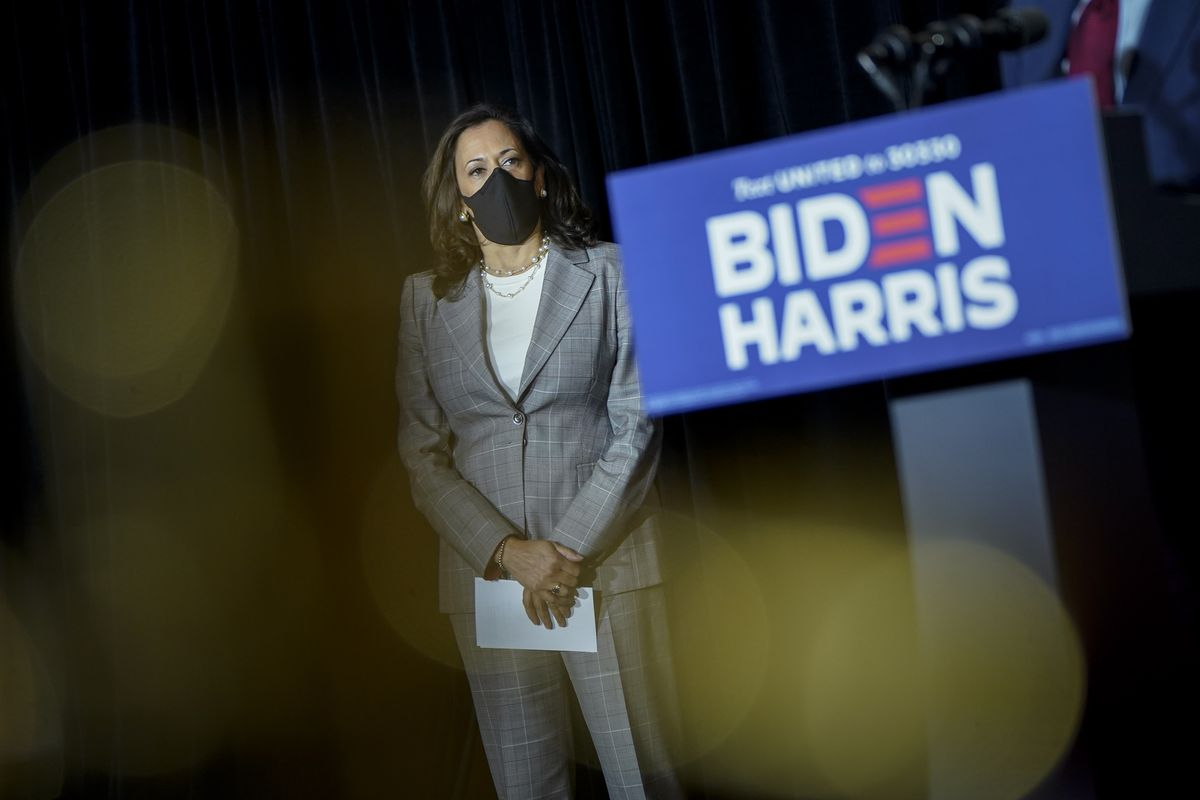 Harris standing with a mask.