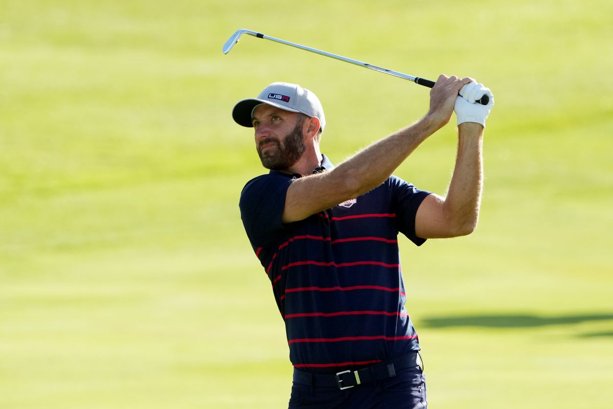 Team USA player Dustin Johnson plays his shot from the ninth fairway during day one foursome rounds for the 43rd Ryder Cup golf competition at Whistling Straits.