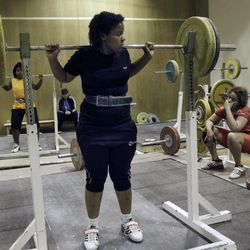 In this Monday, June 18, 2012 photo, Khadija Mohammed, front, who competes in the 75-kilogram category and will be the first female lifter from the Gulf at the Olympics and the first Emirati to qualify for the Olympics outright, practices at the Al Shabab stadium in Dubai, United Arab Emirates.