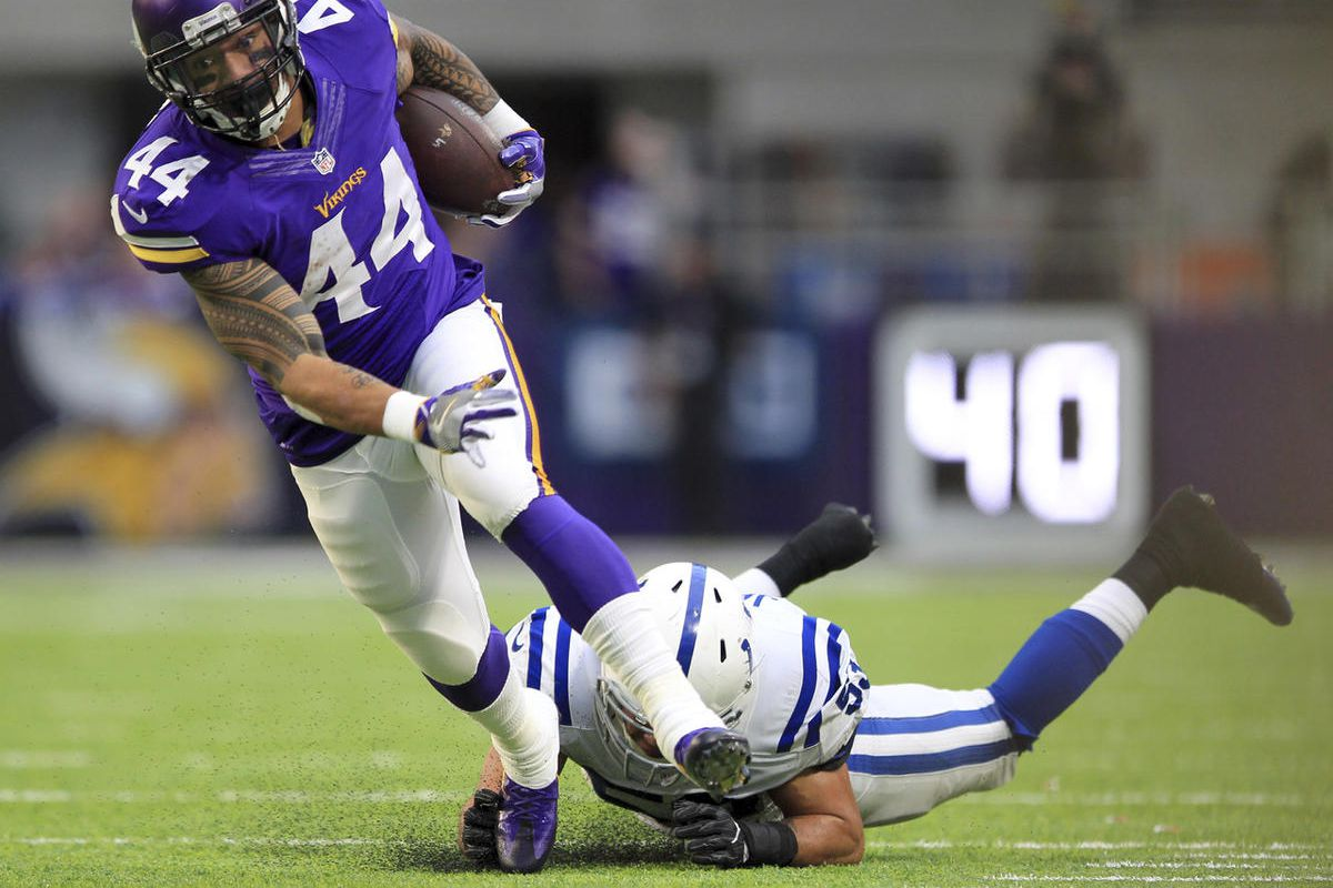 Minnesota Vikings running back Matt Asiata (44) runs with the ball as Indianapolis Colts linebacker Edwin Jackson defends during the second half of an NFL football game Sunday, Dec. 18, 2016, in Minneapolis.