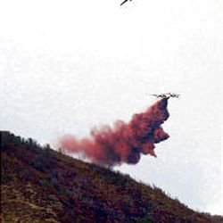 A tanker makes a drop on the Cascade Fire as it burns near Deer Creek Reservoir. The blaze is 10 percent contained.