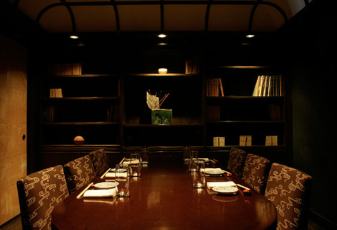 A dark private dining room resembling a library