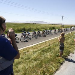 A group of kids take a break from water sports to cheer on racers during Stage 3 of the Tour of Utah near Syracuse on Thursday, Aug. 15, 2019.