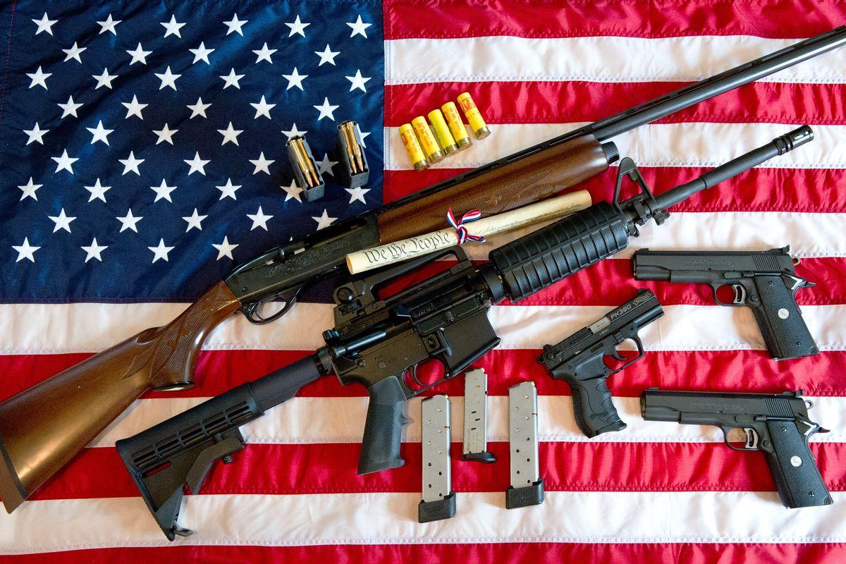 Guns on an American flag.