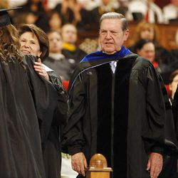 Elder Jeffrey R. Holland, his wife Patricia T. Holland, center and left, and Elder D. Todd Christofferson, right, greet the graduates at LDS Business College's 125th Commencement in the Tabernacle on Temple Square in downtown Salt Lake City Friday, April 13, 2012.