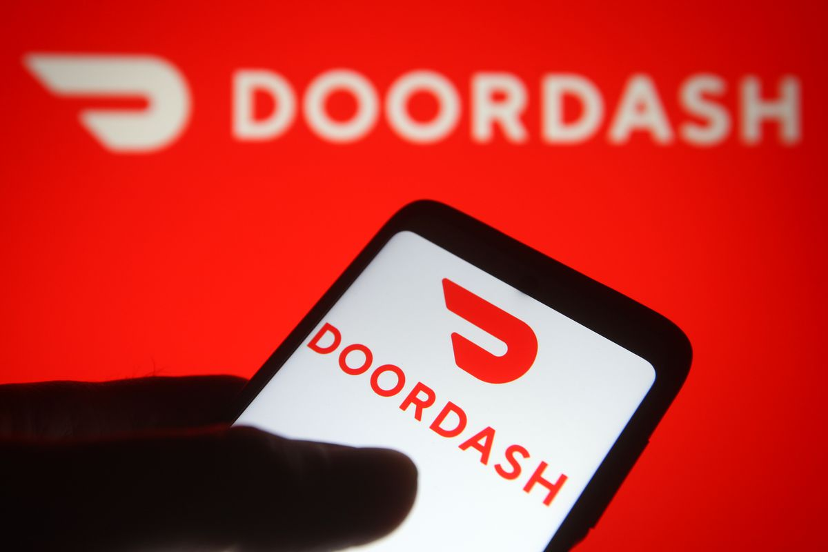 In this photo illustration the DoorDash logo of an US online...
