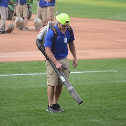6:24 p.m. Blower being used around the visiting team dugout -