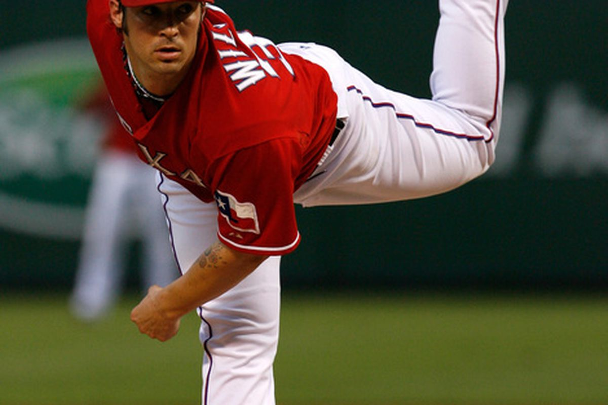 ARLINGTON TX - SEPTEMBER 10:  Starting pitcher C.J. Wilson #36 pitches against the New York Yankees on September 10 2010 at Rangers Ballpark in Arlington Texas.  (Photo by Tom Pennington/Getty Images)