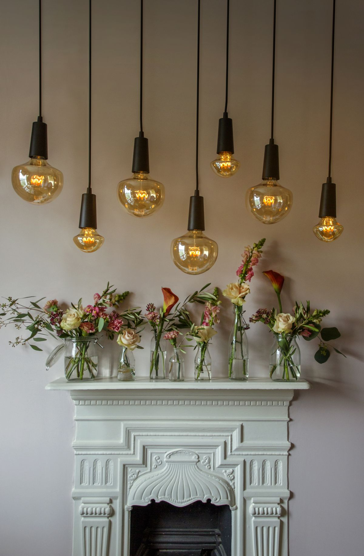 Lights hanging over fireplace mantle