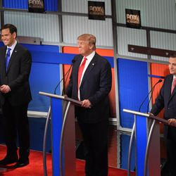 Republican presidential candidate, Sen. Marco Rubio, R-Fla., Republican presidential candidate, businessman Donald Trump  and Republican presidential candidate, Sen. Ted Cruz, R-Texas, from left, participate during the Fox Business Network Republican presidential debate at the North Charleston Coliseum, Thursday, Jan. 14, 2016, in North Charleston, S.C. (AP Photo/Rainier Ehrhardt)