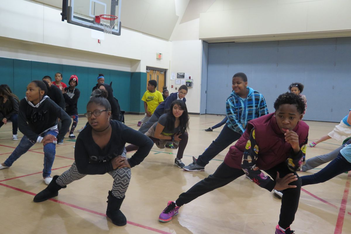 Students at Harrison Hill Elementary School warm up during dance class.