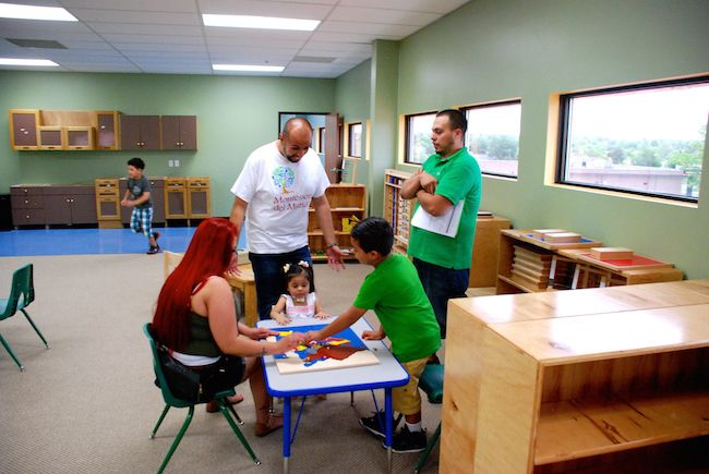 Montessori del Mundo teacher Julio Alas, center, meets with the Castillo family Saturday at an open house. Clockwise from center left is Jahn Sr., Jahn Jr., Yoli, and Yaretzi. Jahn Jr. will attend the school in the fall.