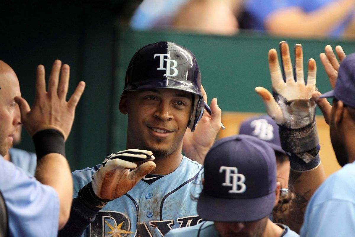 May 5, 2012; St. Petersburg, FL, USA; Tampa Bay Rays left fielder Desmond Jennings (8) is congratulated by teammates after he scored in the first inning against the Oakland Athletics at Tropicana Field. Mandatory Credit: Kim Klement-US PRESSWIRE