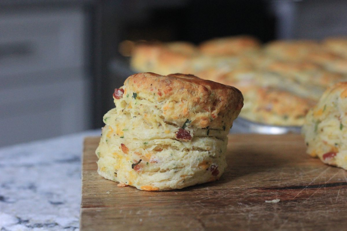 A batch of perfectly risen bacon cheddar chive buttermilk biscuits from Bomb Biscuits in Atlanta