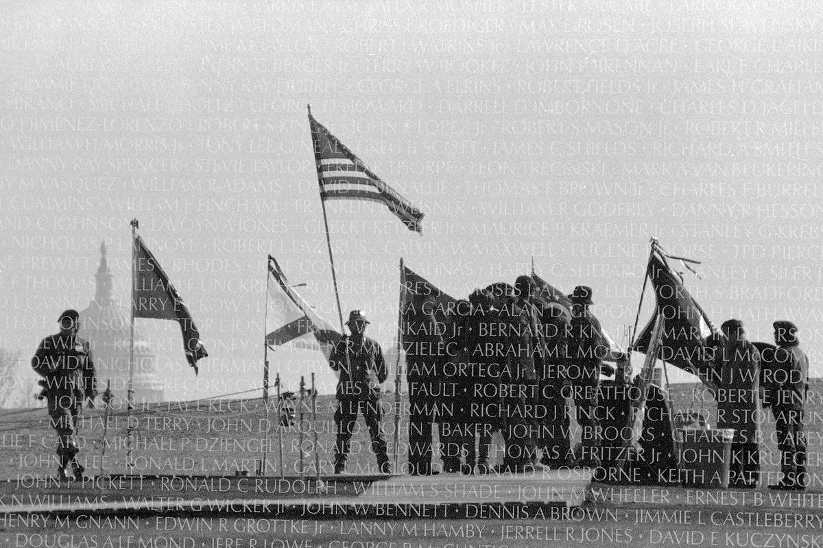 People gather at the Vietnam Veterans Memorial in Washington on Memorial Day 1985.