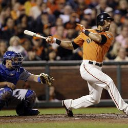 San Francisco Giants' Angel Pagan drives in a run with a single against the Los Angeles Dodgers during the third inning of a baseball game Friday, Sept. 7, 2012, in San Francisco.