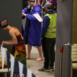 Swimmers prepare to race at the 3A women's swimming state meet at the South Davis Recreation Center in Bountiful on Saturday, Feb. 13, 2021.