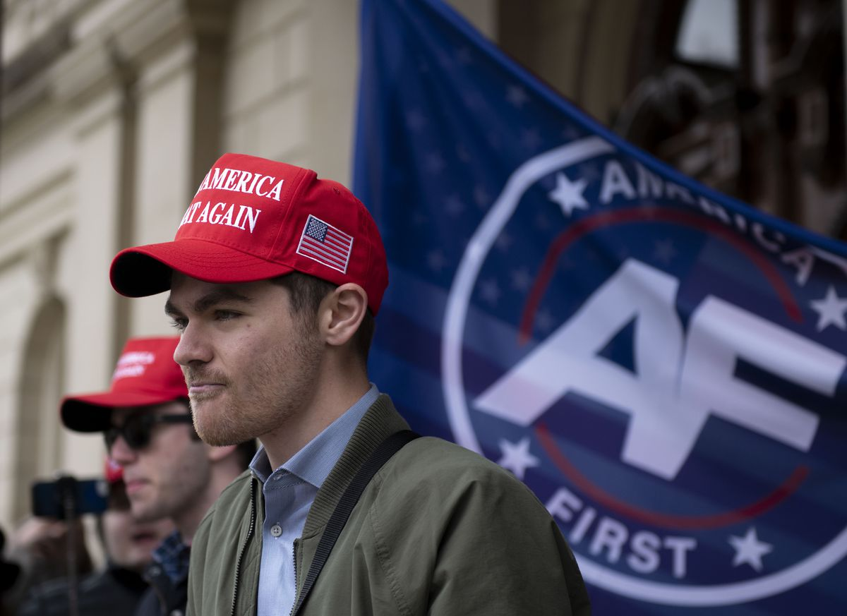 Far right activist Nick Fuentes holding a rally last November at the Michigan State Capitol in Lansing, Mich. Fuentes got a donation of about $250,000 from a French computer programmer in late 2020 and spent the coming weeks encouraging his tens of thousands of followers to lay siege to the U.S. Capitol. The money slipped quietly into the United States, not triggering alerts it might have had it landed via traditional banking channels.