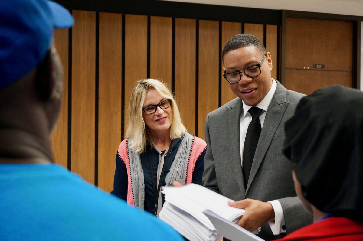 Former school board president Mary Ann Sullivan and former Superintendent Lewis Ferebee accept emails in support of the district's high school reconfiguration plan from parents with Stand for Children Indiana. September 18, 2017.