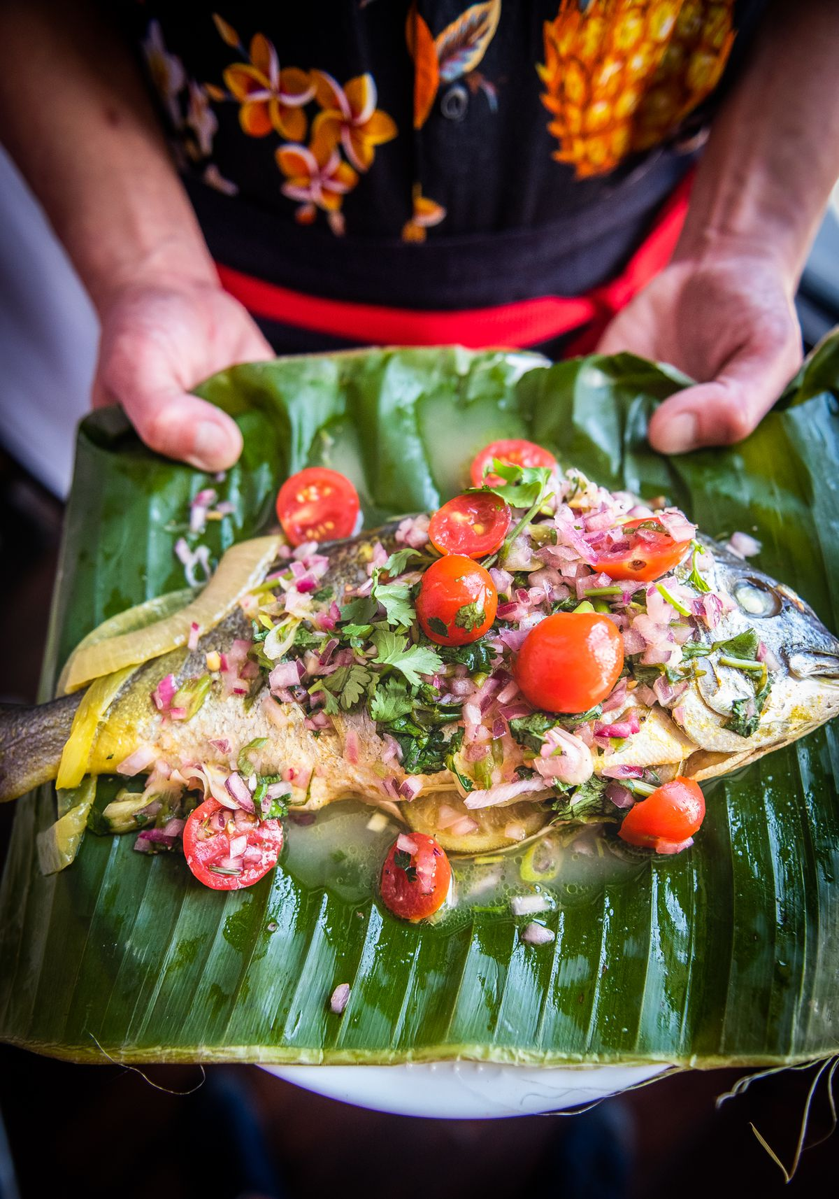 Steamed whole fish with turmeric and citrus.