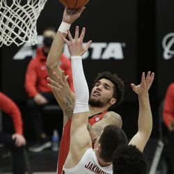 Utah forward Timmy Allen, back, shoots over Washington State forward Andrej Jakimovski during the second half of an NCAA college basketball game in Pullman, Wash., Thursday, Jan. 21, 2021.