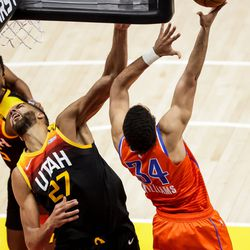 Utah Jazz center Rudy Gobert (27) reacts as Oklahoma City Thunder forward Kenrich Williams (34) is charged with an offensive foul during the game at Vivint Smart Home Arena in Salt Lake City on Tuesday, April 13, 2021.