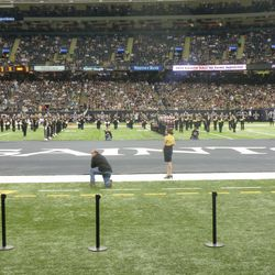 Giant Saints banner on the field during halftime.