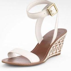 "<a href=""http://www.toryburch.com/Regan-Mid-Wedge-Sandal/11128630,default,pd.html?dwvar_11128630_size=5&dwvar_11128630_color=260&start=192&cgid=sale"">Regan sandal</a>, $192.5 (were $275)"