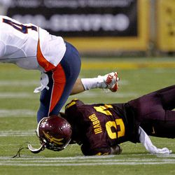 Illinois quarterback Reilly O'Toole (4) is tackled by Arizona State cornerback Osahon Irabor (24) second half of an NCAA college football game, Saturday, Sept. 8, 2012,in Tempe, Ariz.