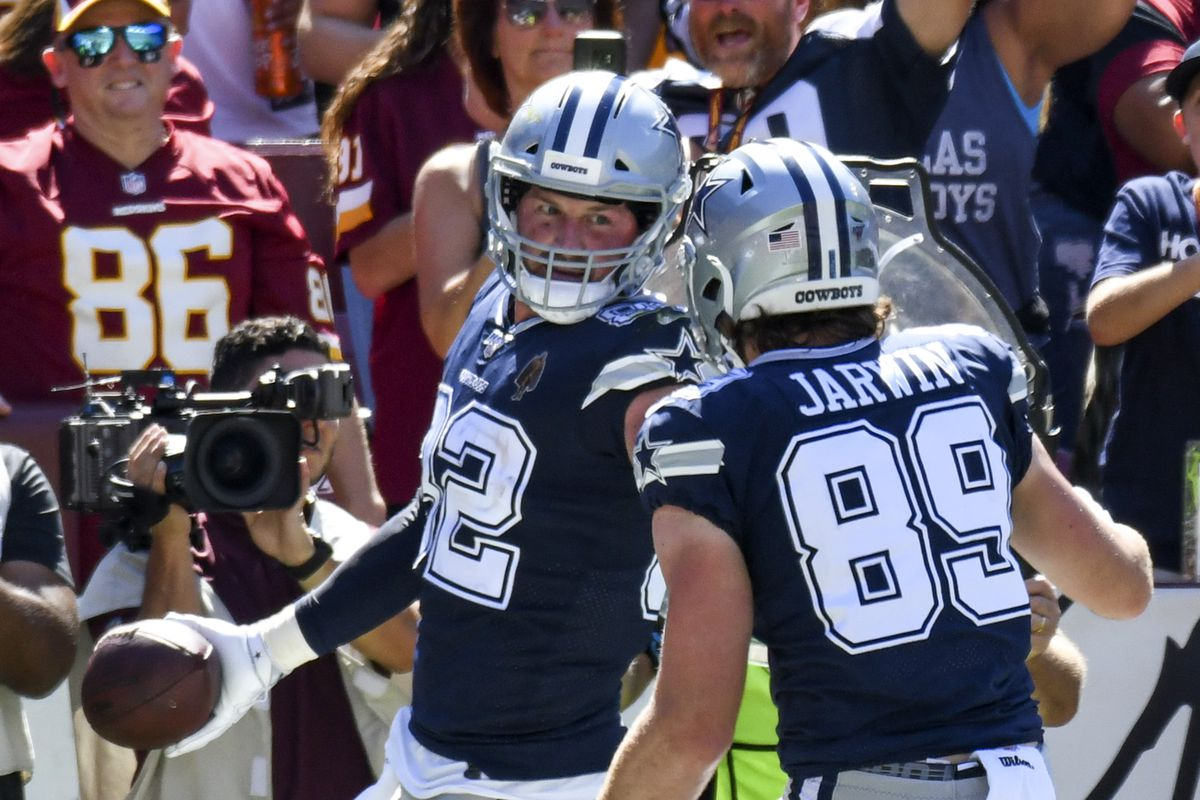 Dallas Cowboys tight end Jason Witten is congratulated by tight end Blake Jarwin after catching a 2 yard touchdown pass in the second quarter against Washington on September 15, 2019, at FedEx Field in Landover, MD.