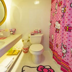 Yep, all the Hello Kitty merch in the bathroom is free for the taking—including the rug and bath curtain.