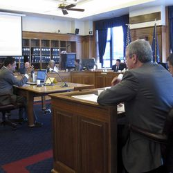 Consultant Janak Mayer testifies before the House Resources Committee and House Special Committee on Energy on Monday, April 23, 2012, in Juneau, Alaska. Mayer, at the center table, testified on the governor's oil tax bill.
