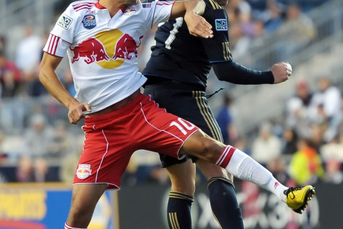 CHESTER PA- OCTOBER 16:  Mehdi Ballouchy of the New York Red Bulls and Eduardo Coudet #21 of the Philadelphia Union go up to head the ball at PPL Park on October 16 2010  in Chester Pennsylvania. (Photo by Drew Hallowell/Getty Images)
